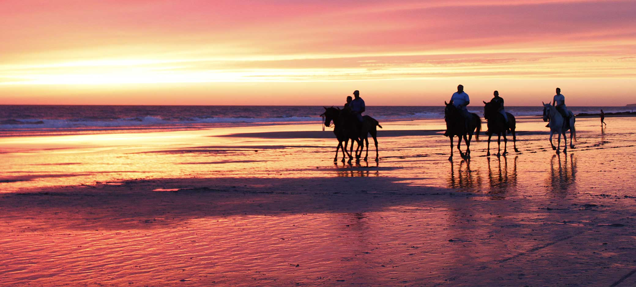 horseback-ride-sunset-beach